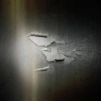 Grunge sfondo metallico con un effetto incrinato e peeling
