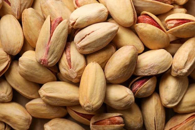 Gustosa arachidi su sfondo intero, da vicino. cibo vitaminico