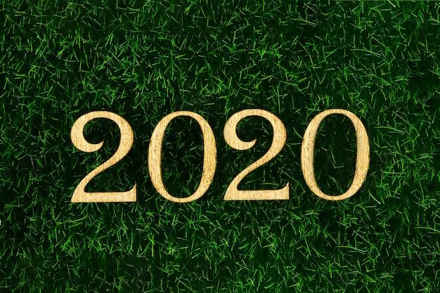 Happy new year 2020. testo creativo happy new year 2020 scritto in lettere di legno oro.