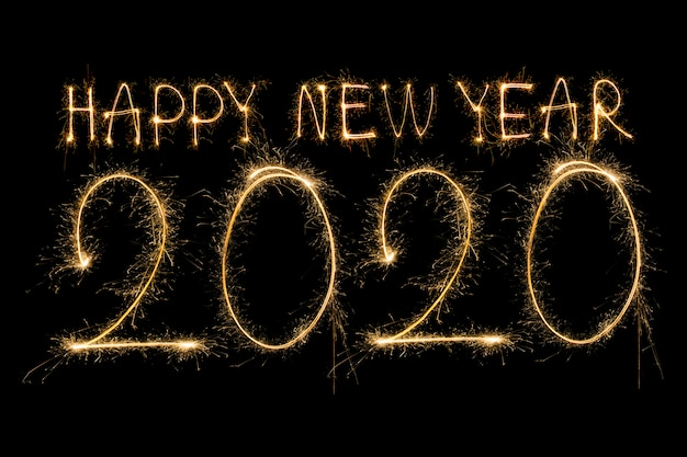 Happy new year 2020. testo creativo happy new year 2020 scritto scintillanti stelle filanti