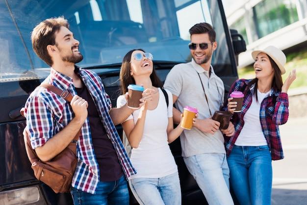 Happy tourists coffee break near bus capote.