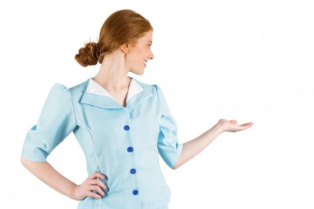 Hostess di aria piuttosto che si presenta con la mano
