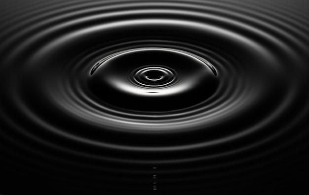 I cerchi sull'acqua divergono in un cerchio, una goccia d'acqua