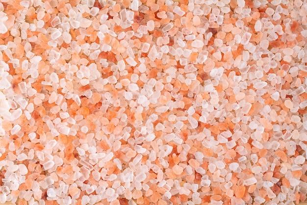 I cristalli rosa himalayani del fondo del sale, sfregano la terapia della stazione termale