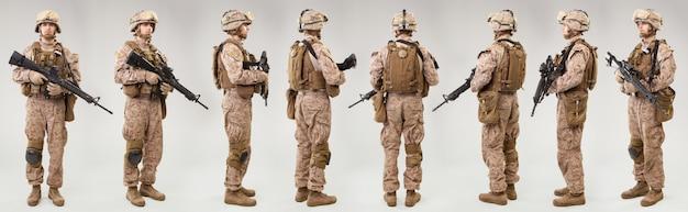 I marines statunitensi costringono i soldati con fucili su grigio. girato in studio. collage