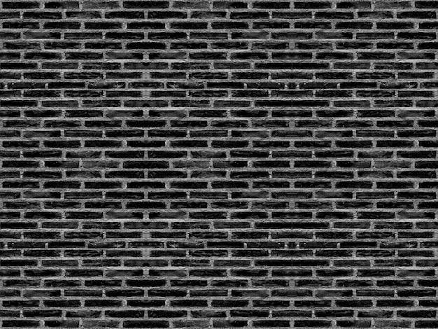 I vecchi blocchi stagionati del mattone del cemento del nero scuro hanno impilato il fondo della superficie di struttura della parete. per qualsiasi opera d'arte vintage.