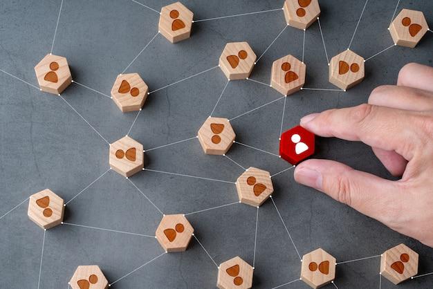 Icona di affari e risorse umane su puzzle esagonale