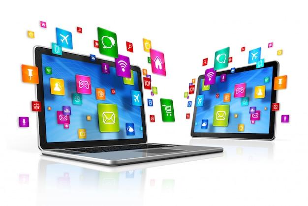 Icone che volano intorno a digital tablet pc e laptop
