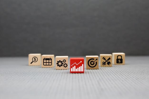 Icone di affari su blocchi di legno.