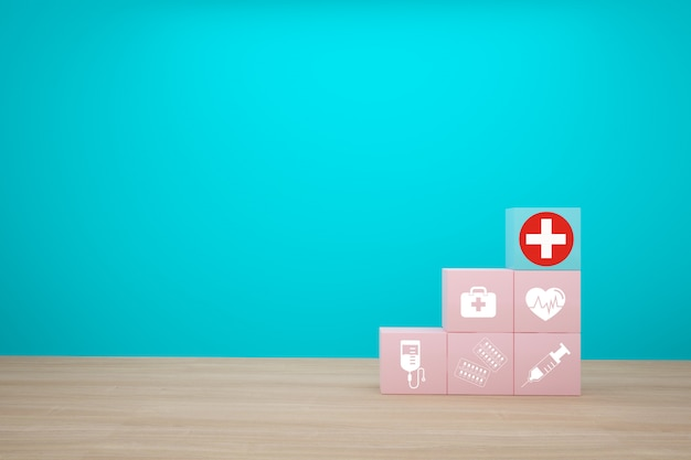 Idea minima di concetto circa dell'assicurazione sanitaria e medica, organizzando l'impilamento di colore del blocco con l'assistenza sanitaria dell'icona medica su fondo blu