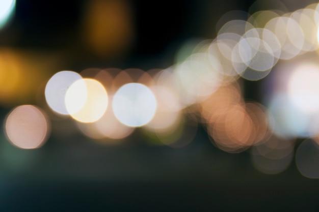 Il bokeh astratto di natale di notte illumina la priorità bassa