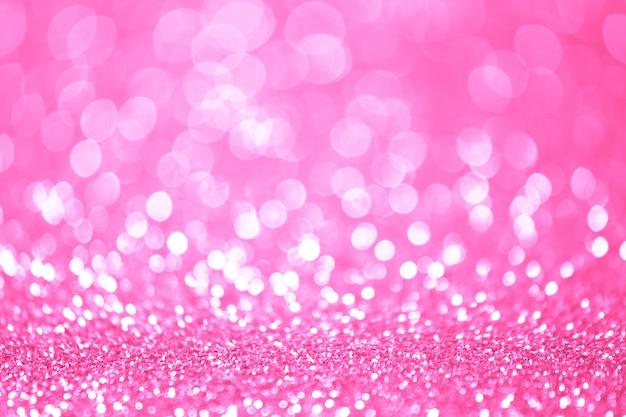 Il bokeh rosa e bianco si accende defocused. sfondo astratto