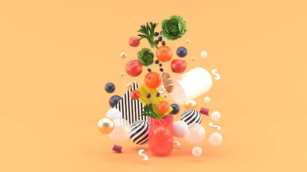Il cibo galleggia fuori dalla capsula in mezzo a palline colorate sull'arancia. rendering 3d
