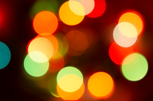 Il colore del bokeh di scintillio illumina la priorità bassa defocused