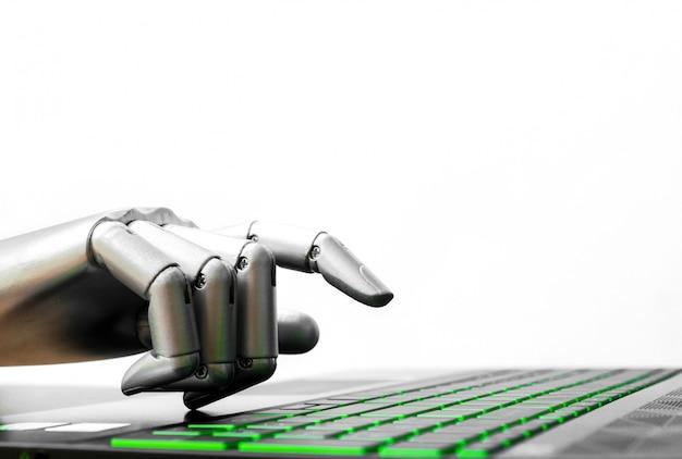 Il concetto del robot o il chatbot della mano del robot che preme la tastiera di computer entrano