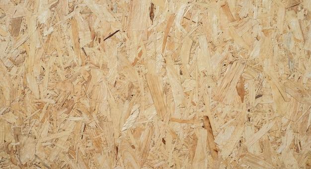 Il foglio osb è realizzato in legno marrone sullo sfondo.