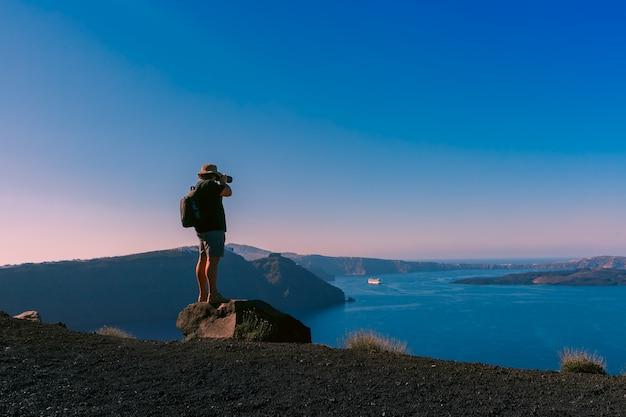 Il fotografo scatta foto caldera, oia, santorini