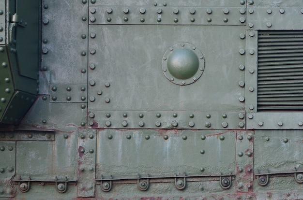Il metallo industriale verde astratto ha strutturato il fondo con i ribattini e i bulloni