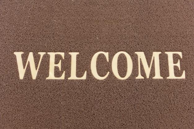 Il nuovo zerbino di testo di benvenuto