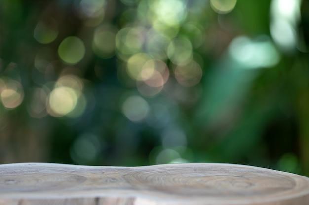 Il pavimento di legno con lo spazio della copia ha fondo del bokeh.