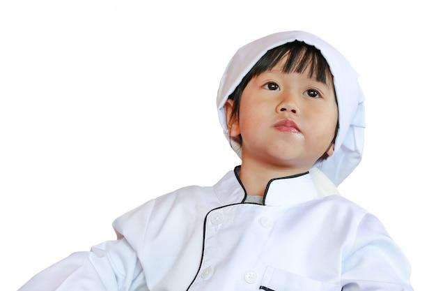 Il piccolo capo è impara mangiando il cibo saporito isolato su fondo bianco