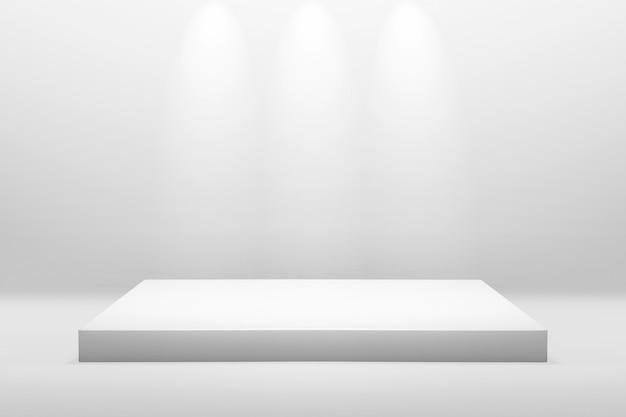 Il podio bianco sta per la mostra o il concetto della presentazione sul fondo moderno della stanza con illumina la luce