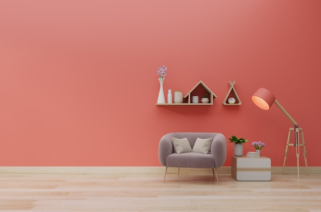 Il salone moderno con la poltrona ha scaffali di legno e del gabinetto sul fondo della parete di colore di corallo, 3d rendering
