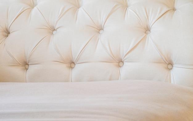 Il tessuto marrone di superficie del primo piano al sofà ha strutturato il fondo