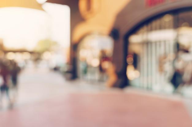 Il tono d'annata ha offuscato il giorno defocused della gente della folla nel festival della via di camminata e nel centro commerciale.