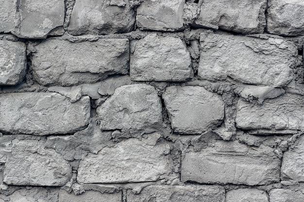 Il vecchio muro è fatto di blocchi di cemento cellulare. avvicinamento