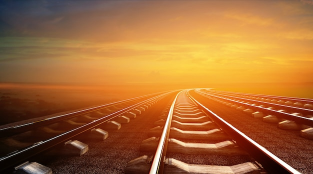 Illustrazione 3d di ferrovie vuote su sfondo cielo al tramonto