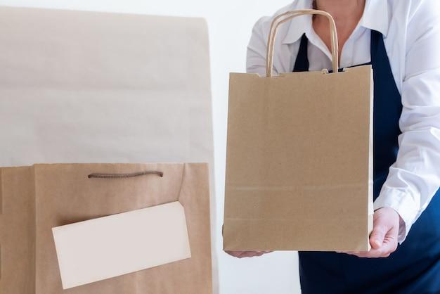 Imballatore del grembiule della scatola del sacchetto dell'imballaggio del servizio di consegna del lavoratore