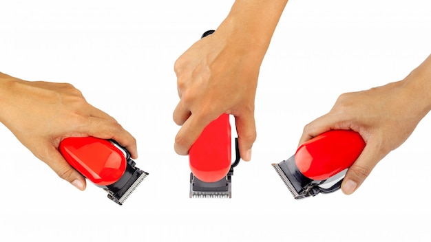 Immagine del primo piano del hairclipper della holding del braccio