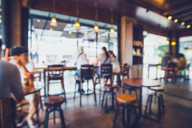 Immagine di sfondo sfocato della caffetteria. astratto sfocatura sfondo con persone nella caffetteria. stile vintage tono colore