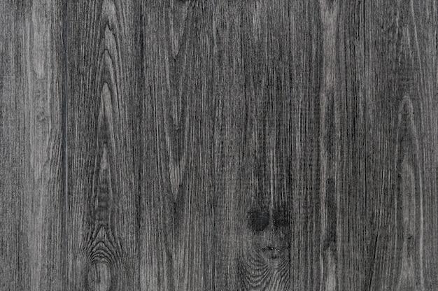 In legno nero, vecchio sfondo grigio scuro, texture vintage