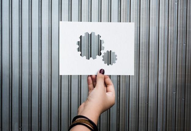 Ingranaggio di carta perforata collegato teamwork aziendale
