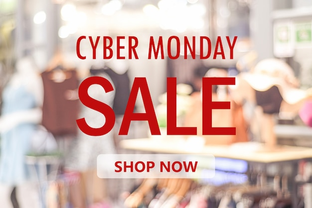 Insegna di vendita di cyber lunedì sopra il fondo del deposito della sfuocatura, lo shopping online, l'affare e la tecnologia