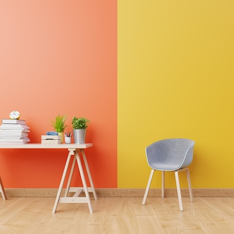 Interiore del salone con pareti arancioni e gialle, pavimento in legno e poltrona blu e legno vicino al tavolo di lavoro. rendering 3d