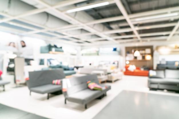 Interno astratto del deposito della decorazione e del magazzino della mobilia della sfuocatura