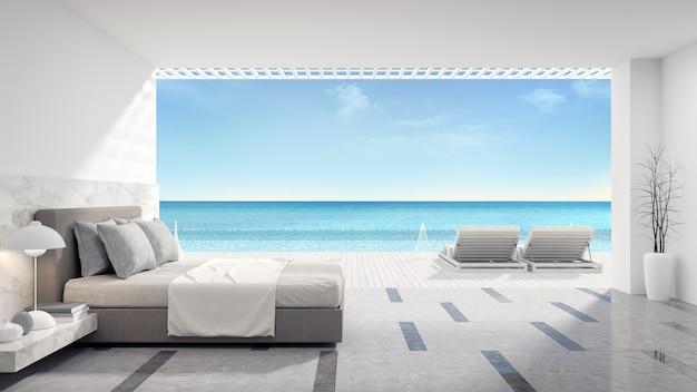 Interno camera da letto moderna con piscina privata vicino alla spiaggia in villa di lusso