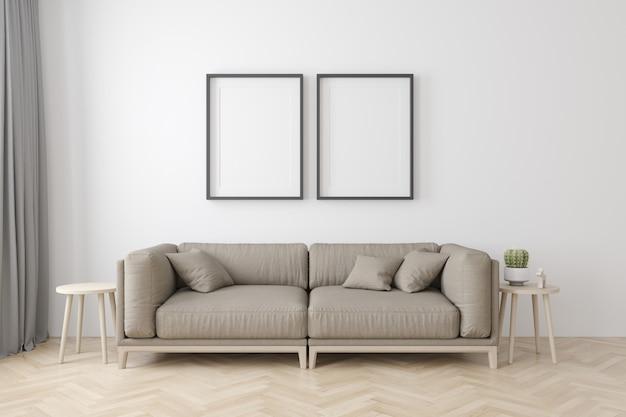 Interno del salotto in stile moderno con divano in tessuto, tavolino e cornici nere vuote sul pavimento in legno