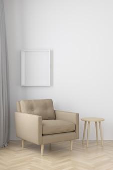 Interno del salotto in stile moderno con poltrona in tessuto, tavolino e cornice nera vuota sul pavimento in legno