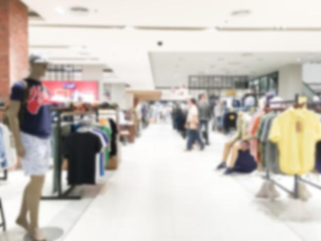 Interno di vendita al dettaglio astratto del centro commerciale e della sfuocatura astratta per fondo