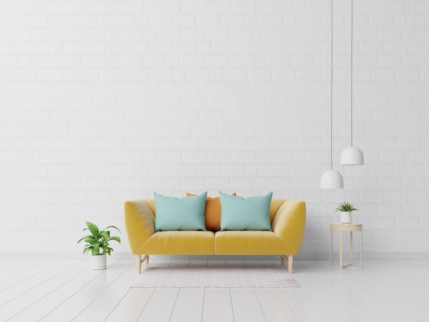 Interno moderno del salone con il sofà e le piante verdi, lampada, tavola sulla parete bianca