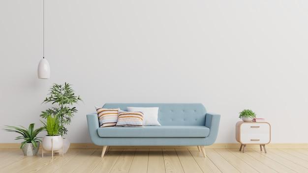 Interno moderno del salone con il sofà e le piante verdi, lampada, tavola sulla parete bianca.