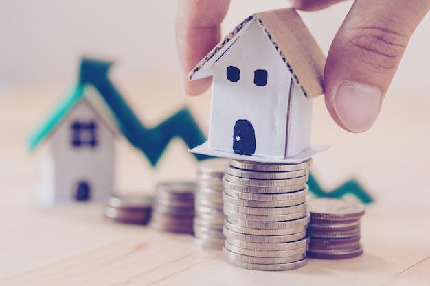 Investimento ipotecario e risparmio per il concetto di immobile