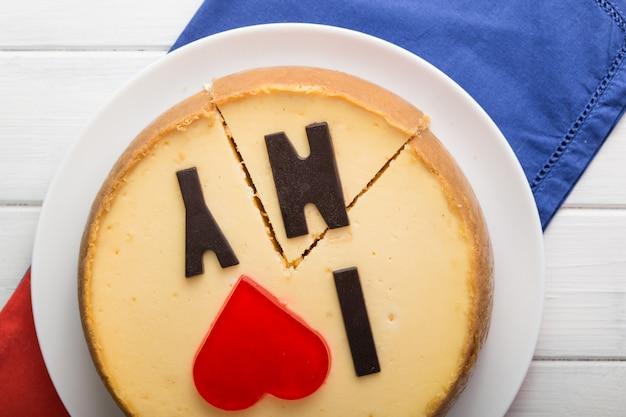 Io amo new york. cheesecake delizioso di new york con la parola. alimento dolce e saporito, concetto della pausa caffè.