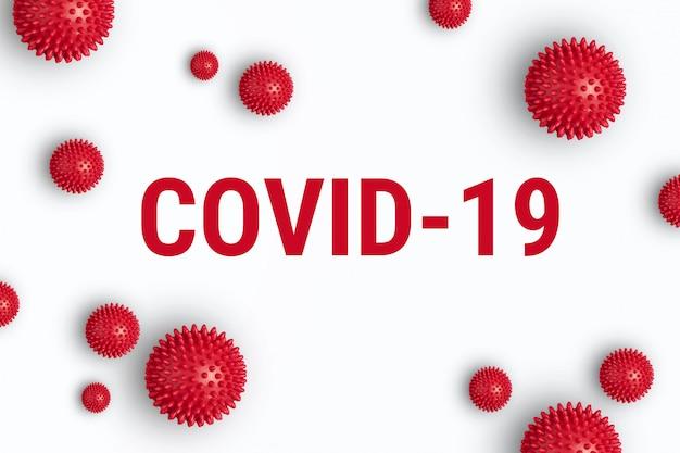 Iscrizione covid-19 su sfondo bianco con modello di deformazione rosso di coronavirus