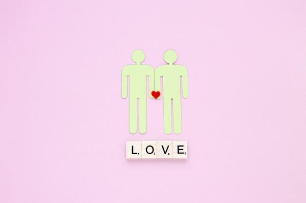 Iscrizione di amore con l'icona di coppia gay