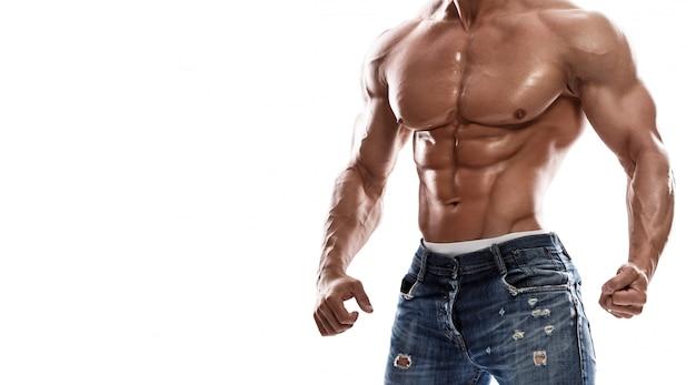 Jeans da portare dell'uomo muscolare
